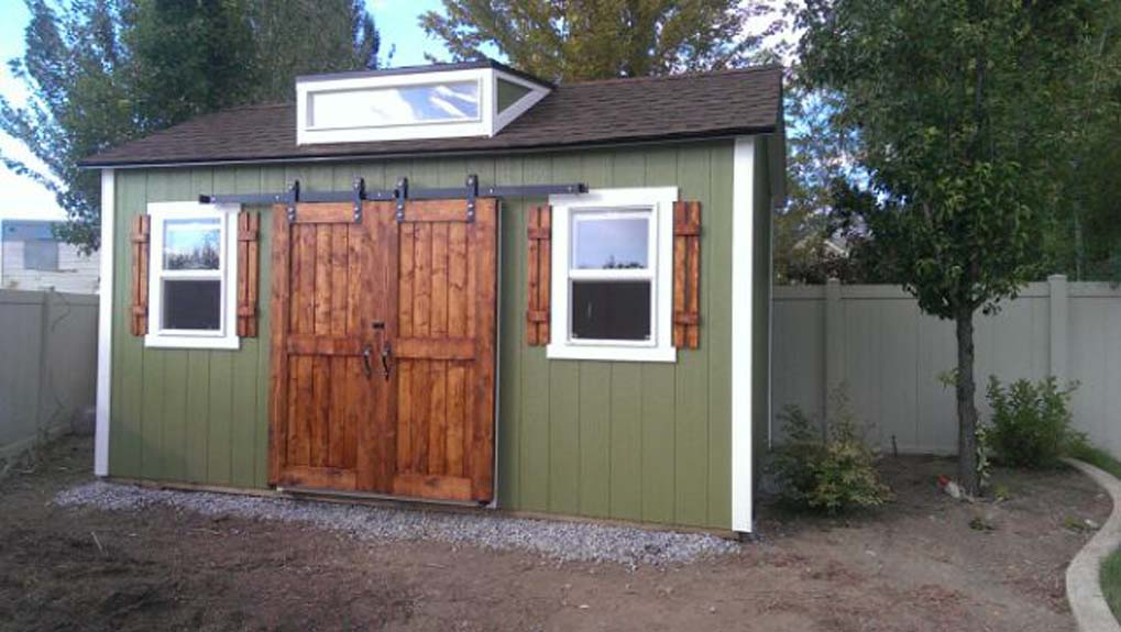 10 x 16 ranch style shed with 6 double sliding barn doors